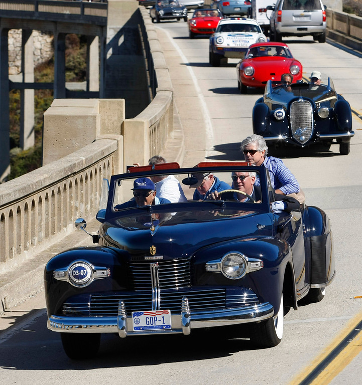 . David Johnson drives his 1942 Lincoln Continental Cabriolet south on Highway 1 over the Bixby Creek Bridge during the Tour d\'Elegance on August 15, 2013.  (Vern Fisher/Monterey County Herald)