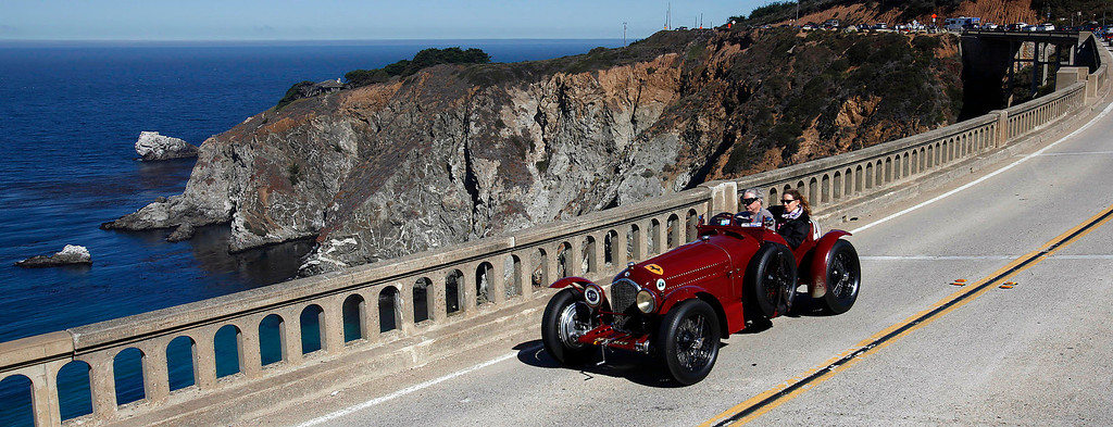 . Greggory Whitten drives his 1932 Alfa Romero  south on Highway 1 over the Bixby Creek Bridge during the Tour d\'Elegance on August 15, 2013.  (Vern Fisher/Monterey County Herald)