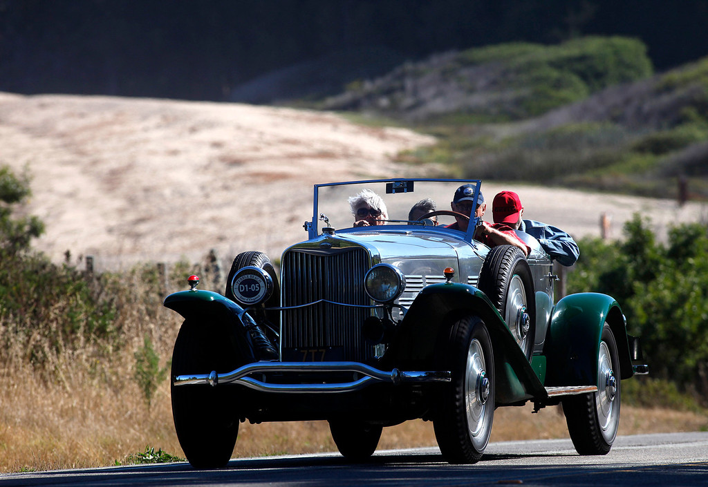 . A 1929 Lincoln LeBaron Aero Phaeton owned by Stan Lucas rolls past Monastery Beach on it\'s way south toward Big Sur on Highway 1 during Pebble Beach Tour d�Elegance in Carmel, Calif. on Thursday August 15, 2013. The Route starts in Pebble Beach, passes through Laguna Seca Raceway, Carmel Valley and Big Sur before returning to the Monterey Peninsula.  (Photo David Royal/ Monterey County Herald)