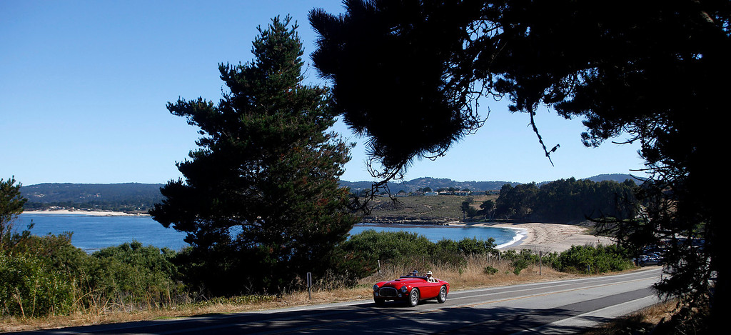 . A Ferrari roll past Monastery Beach on it\'s way south toward Big Sur on Highway 1 during Pebble Beach Tour d�Elegance in Carmel, Calif. on Thursday August 15, 2013. The Route starts in Pebble Beach, passes through Laguna Seca Raceway, Carmel Valley and Big Sur before returning to the Monterey Peninsula.  (Photo David Royal/ Monterey County Herald)