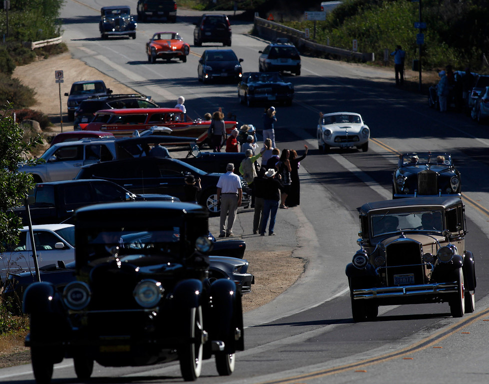 . Classic car fans line up to watch them roll south past Monastery Beach on their way toward Big Sur on Highway 1 during Pebble Beach Tour d�Elegance in Carmel, Calif. on Thursday August 15, 2013. The Route starts in Pebble Beach, passes through Laguna Seca Raceway, Carmel Valley and Big Sur before returning to the Monterey Peninsula.  (Photo David Royal/ Monterey County Herald)