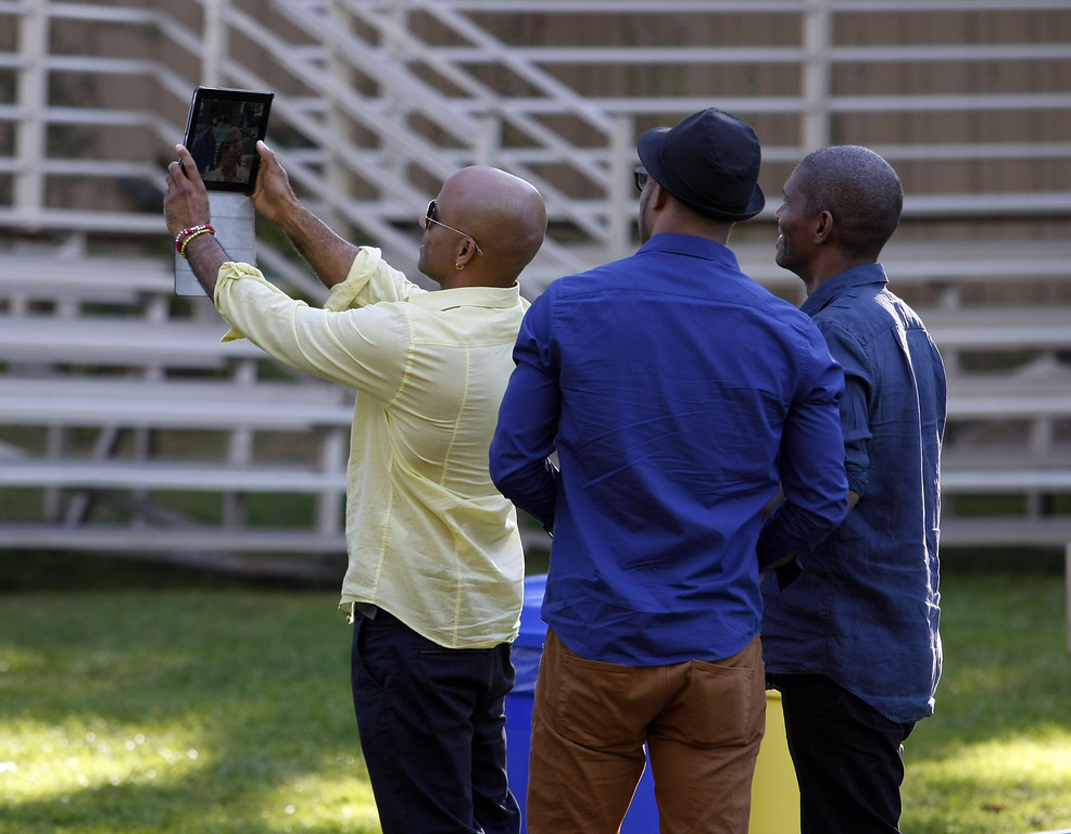 ". Joel Hierrezuelo, Roberto Fonseca and Ramses Rodriguez take a ""selfie\"" prior to their performance  on the Garden Stage during the 56th Monterey Jazz Festival at the Monterey Fairgrounds on Sept. 20, 2013.  (Vern Fisher/Monterey County Herald)"