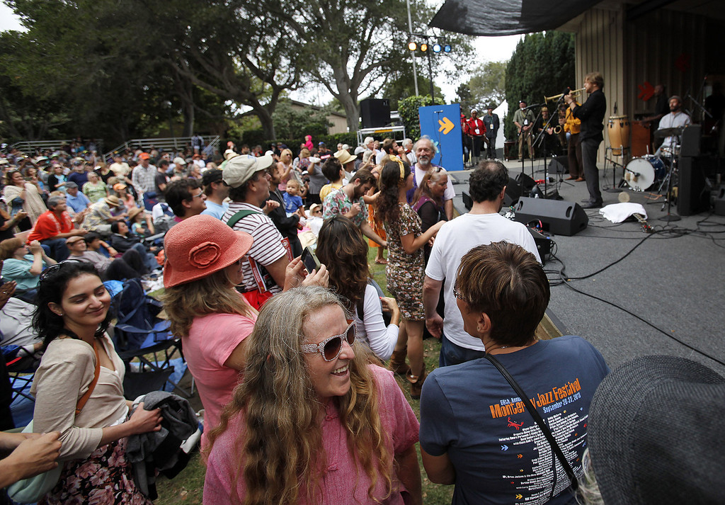 . Crowd enjoying the California Honeydrops fron Oakland on the Garden Stage at the Monterey Jazz Festival on Sept. 21, 2013.  (Vern Fisher/Monterey County Herald)