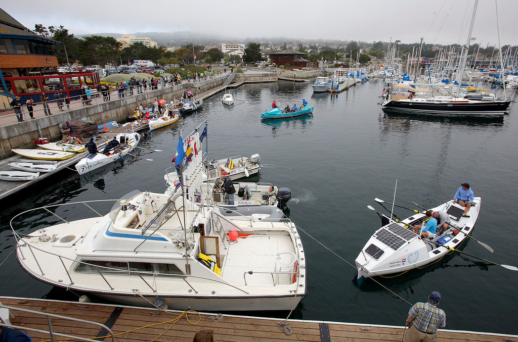 . Entrants start to row out of the harbor in their boats on June 9, 2014 in Monterey for the start of the Great Pacific Race 2014. Thirteen teams from around the world battle it out on a grueling 2,400 mile stretch of the Pacific Ocean from Monterey to Honolulu.  (Vern Fisher - Monterey Herald)