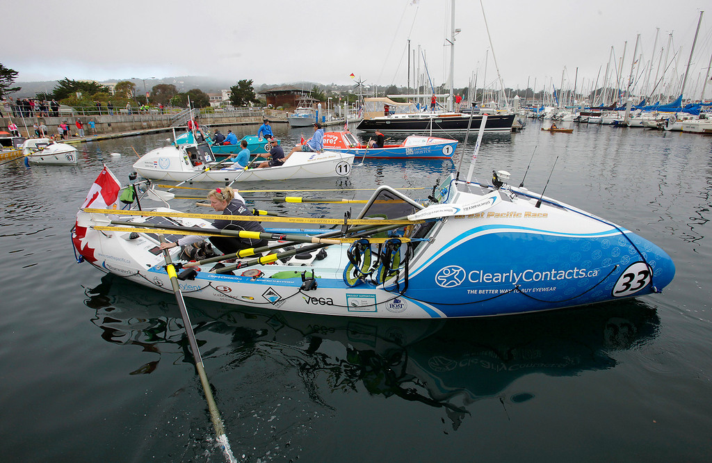 . Rebecca Berger and Leanne Zrumtheir row their boat to the start line on June 9, 2014 in Monterey for the start of the Great Pacific Race 2014. Thirteen teams from around the world battle it out on a grueling 2,400 mile stretch of the Pacific Ocean from Monterey to Honolulu.  (Vern Fisher - Monterey Herald)
