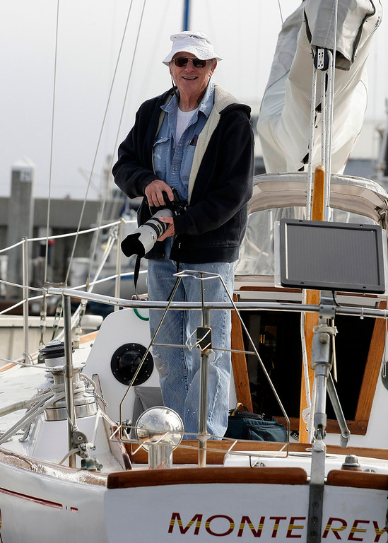 . Steve Gann from Monterey watches entrants prepare their boats on June 9, 2014 in Monterey for the start of the Great Pacific Race 2014. Thirteen teams from around the world battle it out on a grueling 2,400 mile stretch of the Pacific Ocean from Monterey to Honolulu.  (Vern Fisher - Monterey Herald)