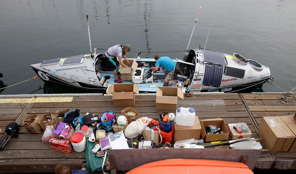 . Entrants prepare their boats on June 9, 2014 in Monterey for the start of the Great Pacific Race 2014. Thirteen teams from around the world battle it out on a grueling 2,400 mile stretch of the Pacific Ocean from Monterey to Honolulu.  (Vern Fisher - Monterey Herald)