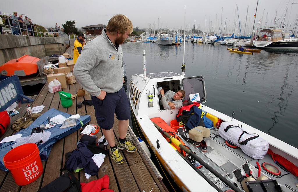 . Mark Gleeson and Chris Blacketer from England and of Team Noman work on their boat on June 9, 2014 in Monterey for the start of the Great Pacific Race 2014. Thirteen teams from around the world battle it out on a grueling 2,400 mile stretch of the Pacific Ocean from Monterey to Honolulu.  (Vern Fisher - Monterey Herald)