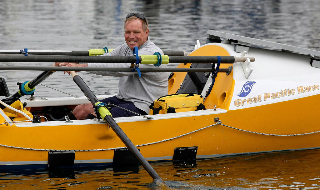 . Jim Bauer rows his boat to the start line on June 9, 2014 in Monterey for the start of the Great Pacific Race 2014. Thirteen teams from around the world battle it out on a grueling 2,400 mile stretch of the Pacific Ocean from Monterey to Honolulu.  (Vern Fisher - Monterey Herald)