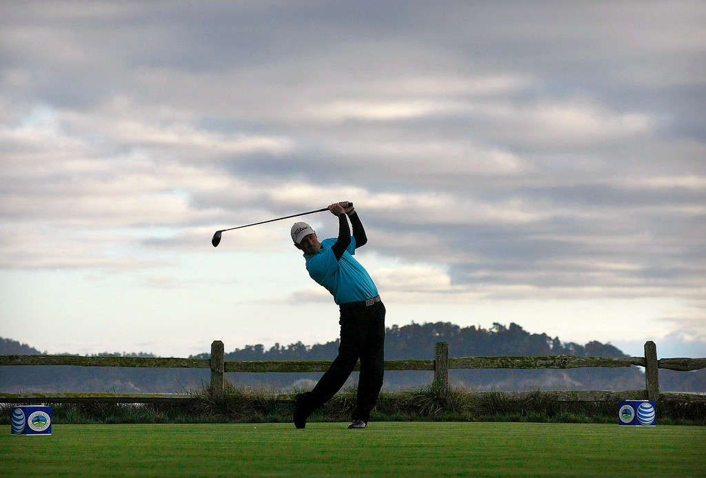 . PGA pro Robert Streb tees off on the 18th hole at the Pebble Beach Golf Links during the first round of the AT&T Pebble Beach National Pro Am on Feb. 6, 2014.  (Vern Fisher/Monterey County Herald)