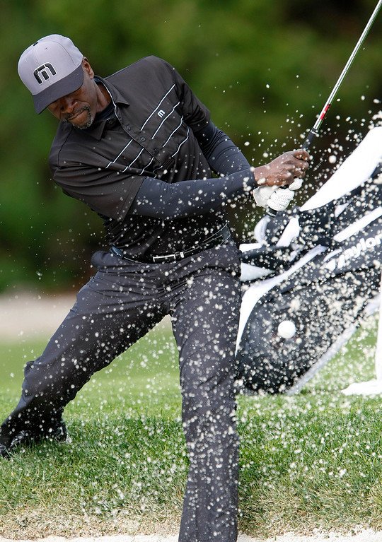 . Actor Don Cheadle blasts out of the trap on the 6th hole at Spyglass Hill during the first round of the AT&T Pebble Beach National Pro Am on Feb. 6, 2014.  (Vern Fisher/Monterey County Herald)