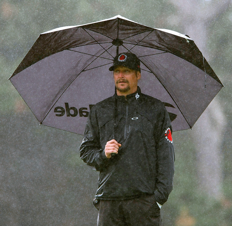 . Kid Rock in the rain at Spyglass Hill during the first round of the AT&T Pebble Beach National Pro Am on Feb. 6, 2014.  (Vern Fisher/Monterey County Herald)
