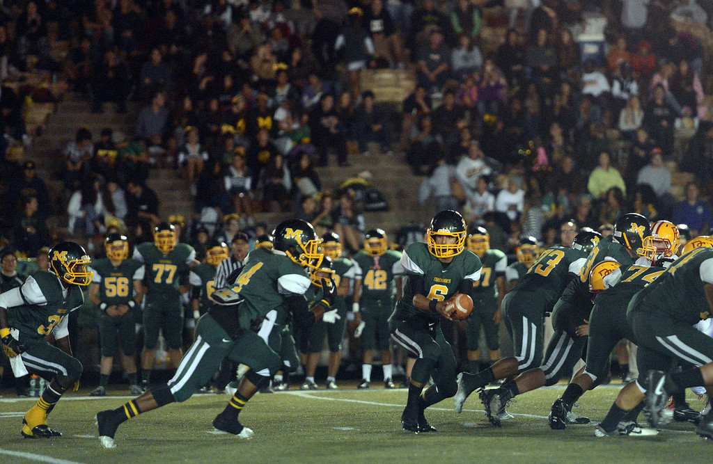 . Monterey quarterback Carter Aldrete hands off to Akili Jones against Pacific Grove during football in Monterey, Calif. on Friday September 20, 2013.  (Photo David Royal/ Monterey County Herald)