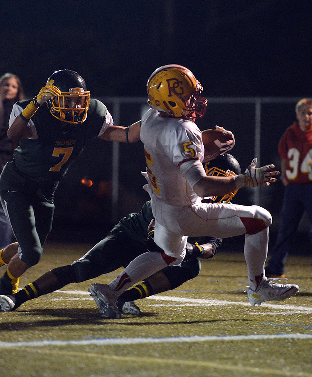 . Pacific Grove\'s Jason Leach scrambles in for a first half touchdown in front of Monterey\'s Anthony Saavedra, left, and Akili Jones during football in Monterey, Calif. on Friday September 20, 2013.  (Photo David Royal/ Monterey County Herald)