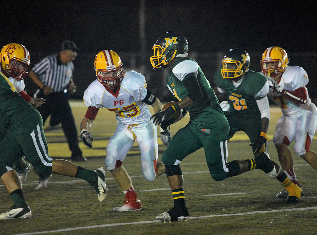 . Monterey\'s Akili Jones runs the ball against Pacific Grove during football in Monterey, Calif. on Friday September 20, 2013.  (Photo David Royal/ Monterey County Herald)