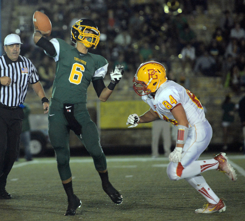 . Monterey quarterback Carter Aldrete fires off a pass under pressure from Pacific Grove during football in Monterey, Calif. on Friday September 20, 2013.  (Photo David Royal/ Monterey County Herald)