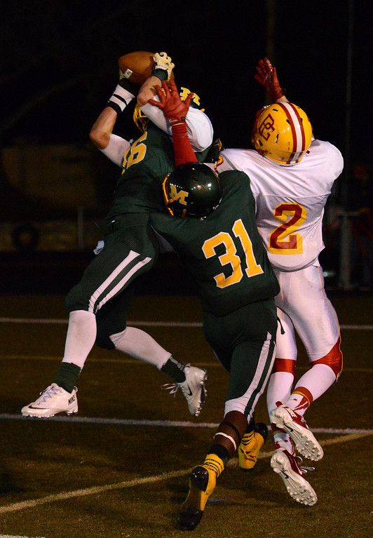 . Monterey\'s Logan Hunter intercepts a pass intended for Pacific Grove\'s Forest Compton during football in Monterey, Calif. on Friday September 20, 2013.  (Photo David Royal/ Monterey County Herald)