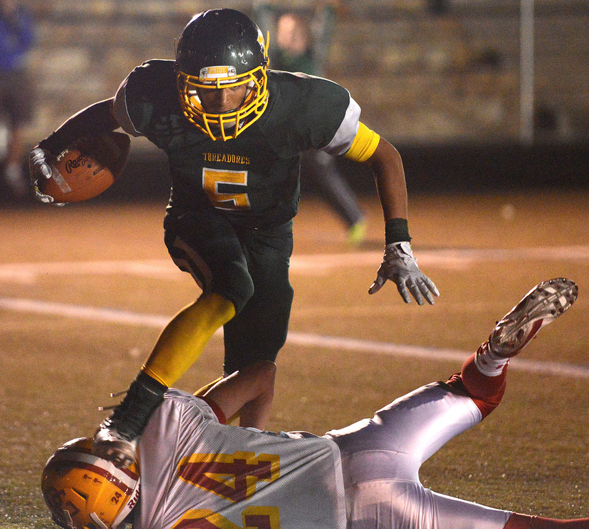 . Monterey\'s Michael Armstead scrambles over Pacific Grove\'s Ryan Richardson for a touchdown during football in Monterey, Calif. on Friday September 20, 2013.  (Photo David Royal/ Monterey County Herald)