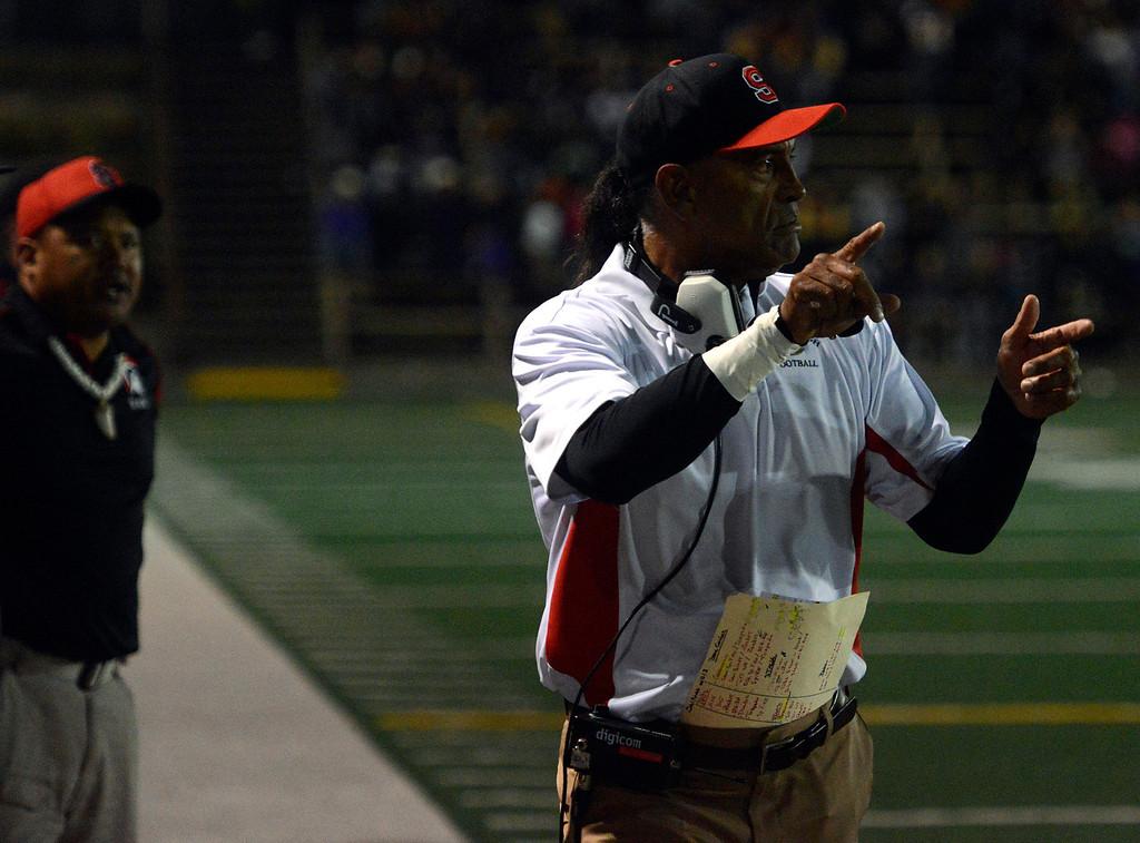 . Seaside coach Al Avila gives instructions to his team during football at Salinas on Friday October 18, 2013. (Photo David Royal/ Monterey County Herald)
