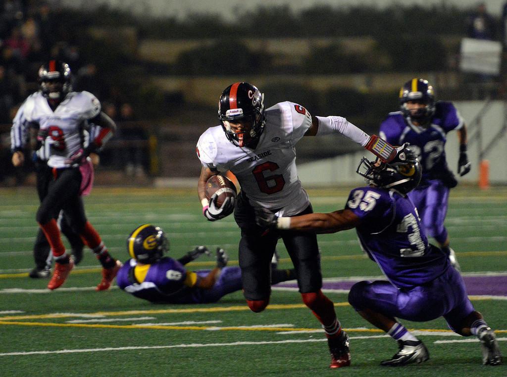 . Seaside\'s Ronnie Turner hammers past Salinas\' Sergio Guzman during football at Salinas on Friday October 18, 2013. (Photo David Royal/ Monterey County Herald)