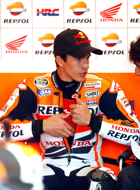 . Current MotoGp points leader Marc Marquez from Spain, talks with his crew in the Repsol Honda Team garage at Mazda Raceway Laguna Seca during the first day of practice on July 19, 2013.  (Vern Fisher/Monterey County Herald)