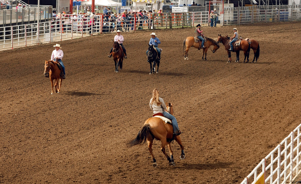 . Horse riders take advantage of a empty track prior to the California Rodeo Salinas on July 18, 2013.  (Vern Fisher/Monterey County Herald)